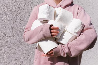 woman-in-pink-long-sleeve-hoodie-carrying-tissue-rolls-3962433