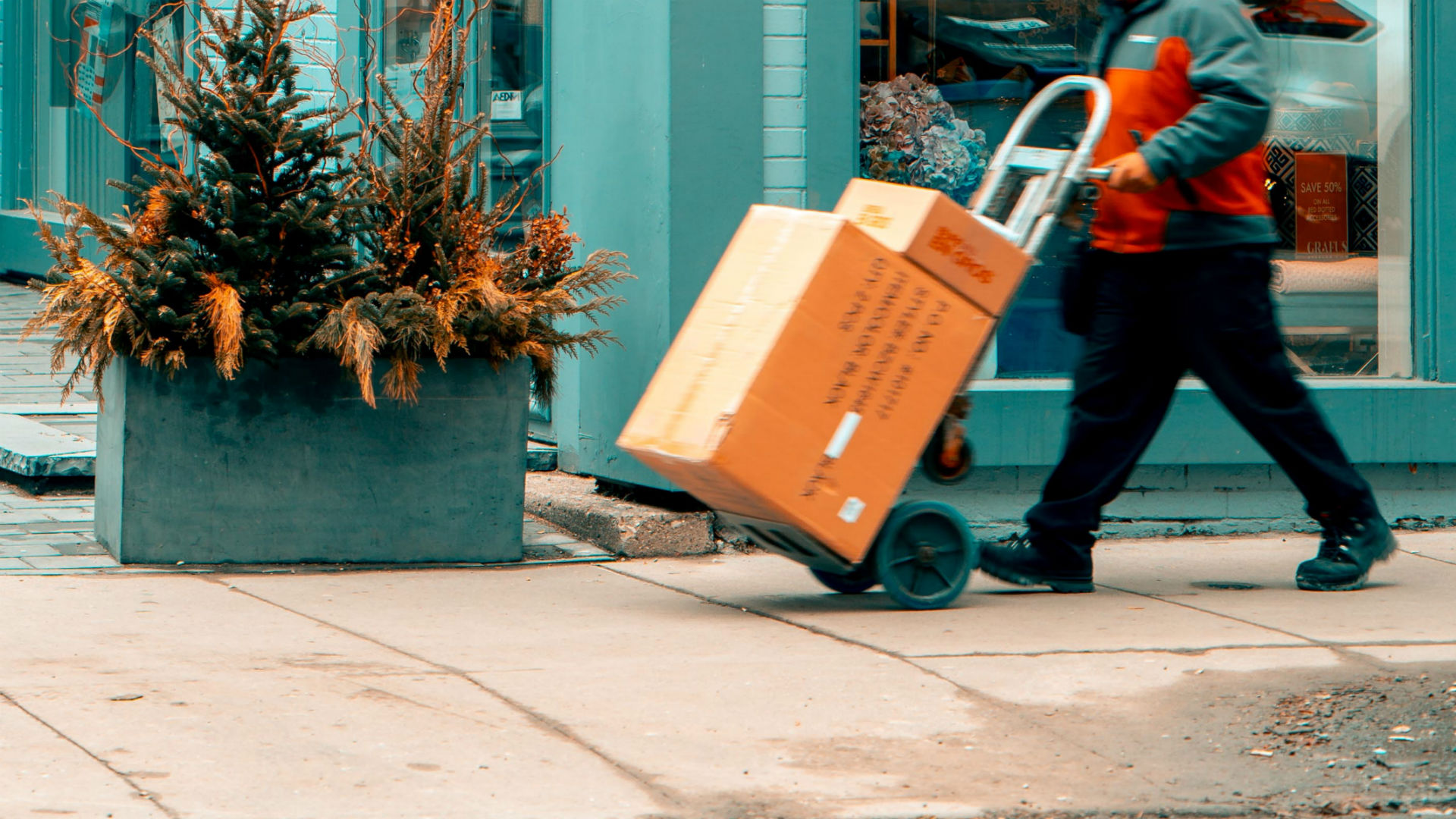 Man pushing handtruck